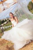 Постер, плакат: happy newly wed bride MOVEMENT IN DRESS BRIDE IS TWIRLING ROUND  ANY DETAILS ON THE BRIDES DRESS