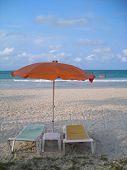 Two Deck Chairs Facing Beach At Bintan, Indonesia