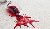 Red wine glass dirty carpet.