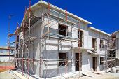 Construction Of Building Of New Two-story White Concrete House With Stairs And Balcony