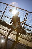 picture of stratocaster  - cool guy playing his guitar against sunlight