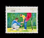 Vintage Postage Stamp Of Young Boy Being Taught How To Play Golf With Clipping Path