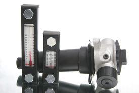 stock photo of plumper  - two thermometers and metal element used in hydraulic construction - JPG