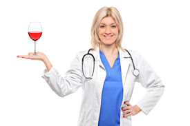 picture of wine-glass  - A female medical doctor holding a wine glass isolated against white background - JPG