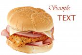 Chicken cordon bleu sandwich  - breaded and seasoned fried chicken breast, baked ham, and swiss cheese on fresh bakery bun - isolated on white background.