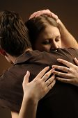 foto of atonement  - Couple in an embrace on an dark background - JPG