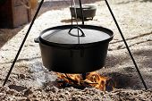 picture of dutch oven  - dutch oven cooking over open flame - JPG