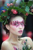 MOSCOW - OCTOBER 2: Beautiful model with bodyart