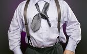 stock photo of frazzled  - An overweight businessman with a bad knot in his necktie - JPG