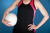 Woman In Athletic Clothes Holding A Volleyball