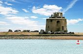 image of martello  - old martello tower eastbourne england with blue sky and clouds - JPG