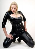 stock photo of bombshell  - Busty blonde bombshell model wearing a black outfit - JPG