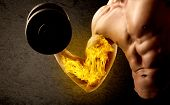 Muscular bodybuilder lifting weight with flaming biceps concept on background poster