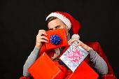 Man Holds Xmas Presents. Santa With Relaxed Face With Gifts poster