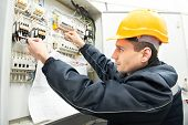 One electrician builder at work with assembly drawing inspecting high voltage power electric line di