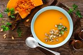 Pumpkin Soup. Vegetarian Soup With Pumpkin Seeds In Bowl On Wooden Table, Top View poster