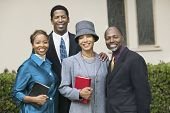 stock photo of ecclesiastical clothing  - Friendly Couples Going to Church on Sunday - JPG