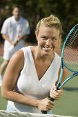Woman Playing Tennis at Net