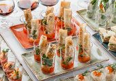 Delicious Appetizers In Glass Cups On Banquet Table. Catering Food, Canape And Snacks poster