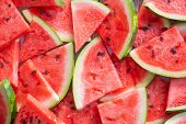 Summer ripe sliced watermelon, top view. Juicy slice of ripe watermelon. Concept summer watermelon.  poster
