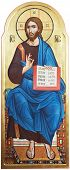 religious orthodox icon of sitting Lord Jesus Christ God with open bible painted on wooden board wit