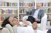 Psychotherapy: Psychologist and patient at office