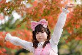 japanese lolita portrait in park during fall season, Tokyo