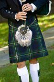 stock photo of bagpipes  - Scottish bagpiper playing bagpipes - JPG