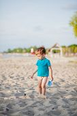 Boy Playing On Beach. Child Play At Sea On Summer Family Vacation. Sand And Water Toys, Sun Protecti poster