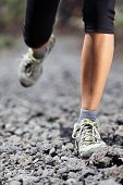 picture of close-up  - Trail runner woman running on mountain path with rocks - JPG