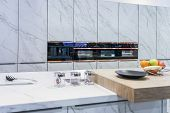 Modern, Bright, Clean Kitchen Interior With Stainless Steel Appliances In A Luxury Apartment. poster