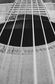 Details Of An Old Acoustic Guitar, The Sound Hole, Frets And Nylon Strings. Wooden Acoustic Guitar,  poster