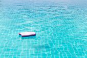 Swimming Foam Pad Are Floating In The Large Swimming Pool. poster