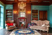 Luxury Classic Interior Of Home Library. Sitting Room With Bookshelf, Books, Arm Chair, Sofa And Fir poster