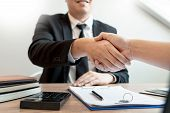 Customer And Broker Shake Hands Agreeing To Buy New House At Meeting After Making Sale Purchase Deal poster
