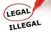 stock photo of illegal  - Choosing Legal instead of Illegal - JPG