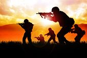 image of assault-rifle  - Silhouette illustration of a group of soldiers in assault formation - JPG