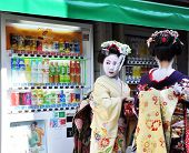 Kyoto, Japan - Oct 21 2012: Japanese Ladies In Traditional Dress  On A Street Leading To Kiyomizu Te