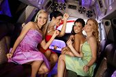 pic of hen party  - Attractive girls in evening dress having party in limo - JPG