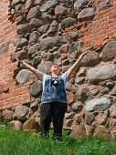 Relaxed Happy Mature Woman Outdoor Wall