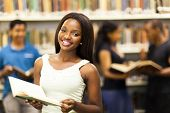 picture of librarian  - beautiful african american college girl in library - JPG