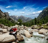 stock photo of himachal pradesh  - Hiker trekkers read a trekking map on trek in Himalayas mountains - JPG