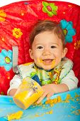 Happy Baby Eating Puree