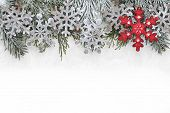 Christmas decoration with fir branch, Christmas snowflake and snow