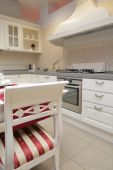 foto of dutch oven  - chair in interior of the light kitchen in classical style  - JPG