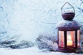 stock photo of glow  - Christmas lantern with snowfall - JPG