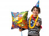 Child Smiling and having fun during his birthday party. Over white background. Happy Boy smiling