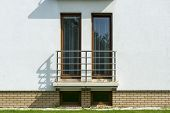 Wooden Tall Windows In White Wall