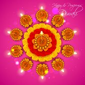 stock photo of rangoli  - illustration of decorated Diwali diya on flower rangoli - JPG
