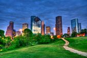 Houston Texas modern skyline at sunset twilight from park lawn